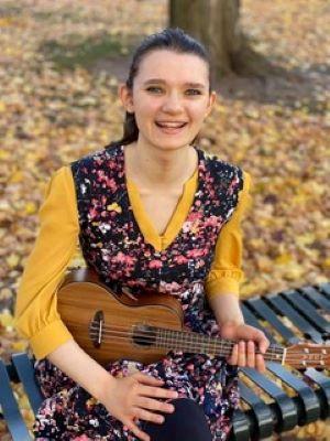 holding ukulele